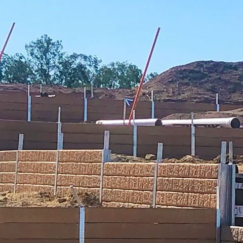 What is the preparation involved in building a retaining wall.